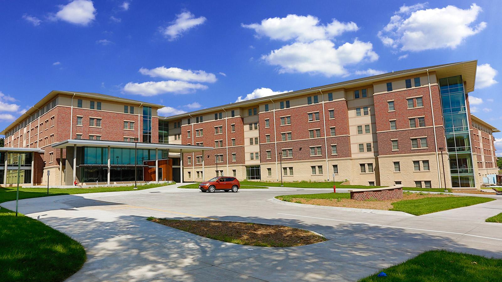University Suites exterior of building in summer light.