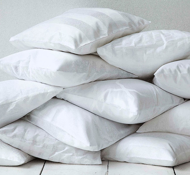 Photo of a pile of clean white puffy pillows