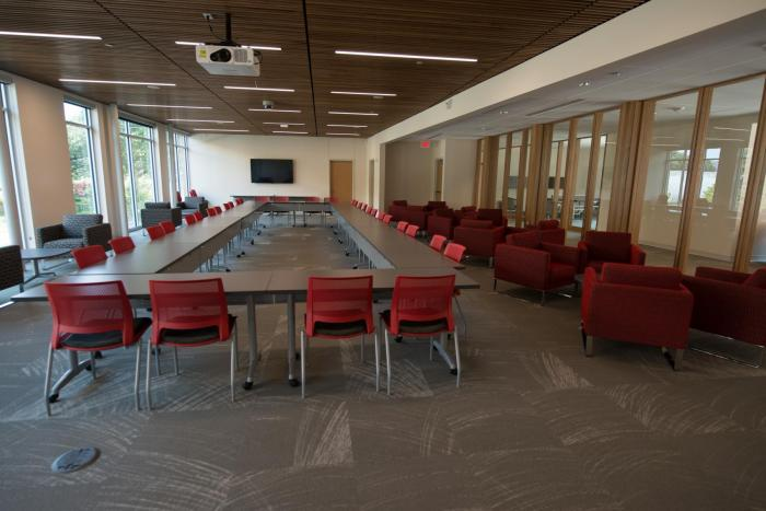 Comfortable seating with conference room tables, LCD projector, and Flat Screen TV.