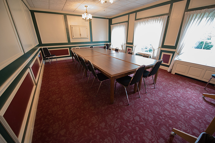 Large room with large conference table and wall of windows.