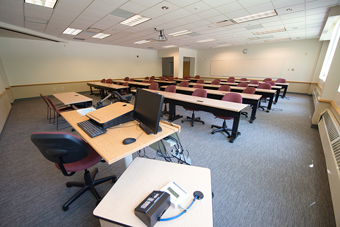 Large classroom-like space with tables/seats for 40+ and instructor table.