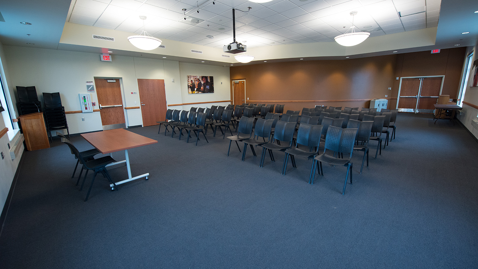 Meeting room in Gaughan Center filled with chairs and projector.